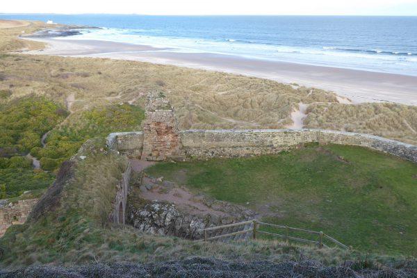 Bamburgh Castle ruins overhead