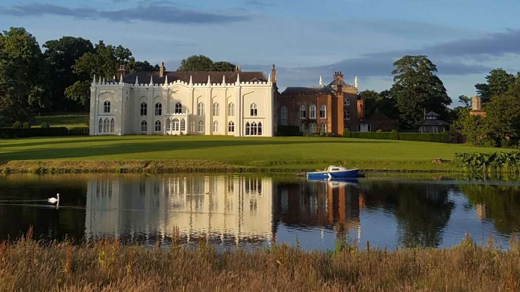 Combermere Abbey across the lake