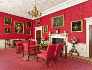 Fairfax House red wallpaper with paintings