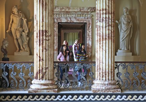 Holkham Hall visitor experience among historic columns