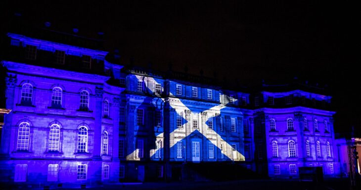 Hopetoun House in Scotland projects the Scottish flag on the walls