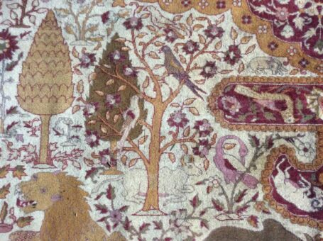 Silk woven rug of Broadward Hall lion and birds