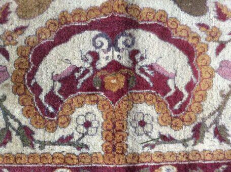 Silk rug of Broadward Hall rams fighting