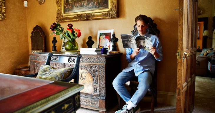 Teenager reading magazine Sudeley