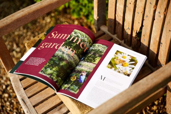 Historic House Magazine on chair in sun